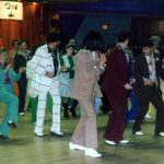 People dancing in leisure suits