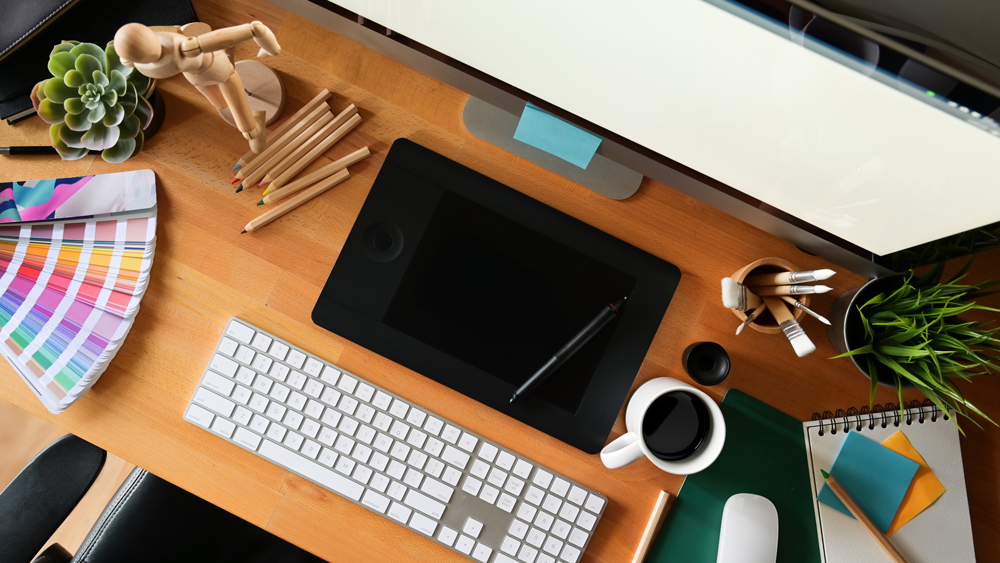 An artist's desk cluttered with design tools